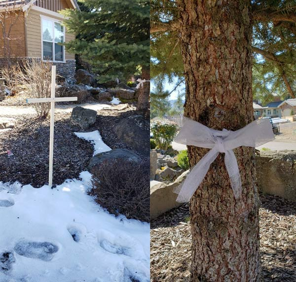 Cross in year, bow on tree